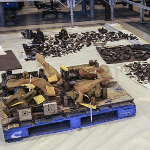 The fragments and components of the failed piston were collected and sent to a metallurgist to determine the failure mode.